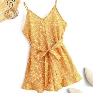 Yellow romper covered with cute dotted prints.